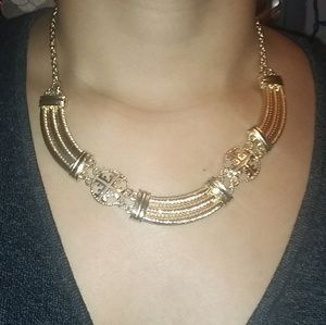 Feminine gold tone necklace